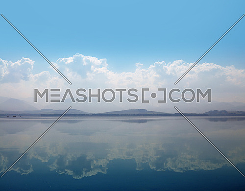 Waterscape of lake water with cloudy sky reflection