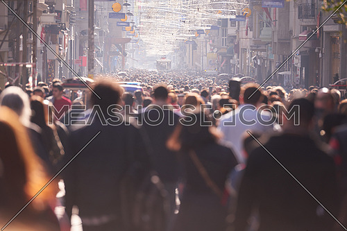 people crowd walking on busy street on daytime