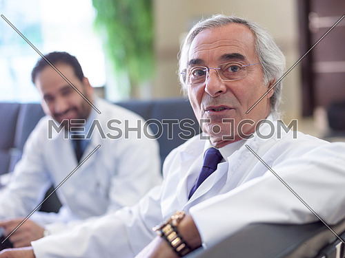 mature doctor portrait in modern hospital