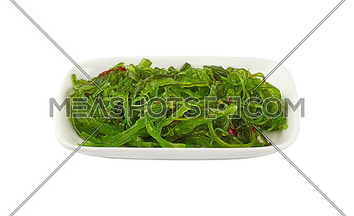 Close up portion of green wakame seaweed salad on white plate isolated on white background, high angle view