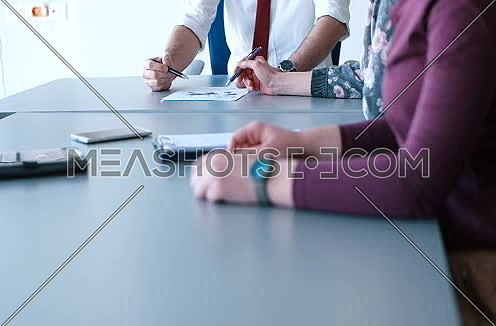business people having meeting in bright office making plans for business