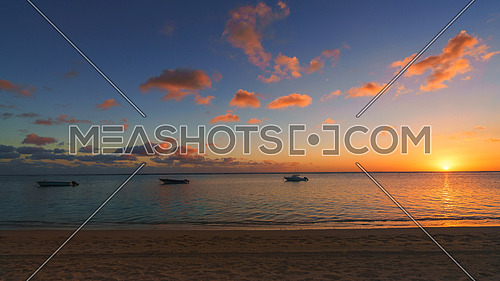 Amazing sunset at Mauritius panorama,Fishing boat at sunset time.
