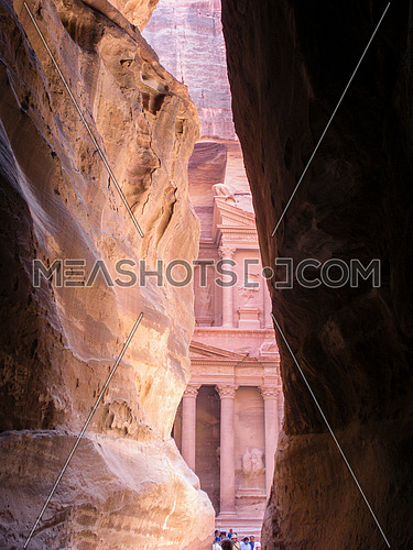 The historical site Petra appears from between two huge mountain passage, Jordan