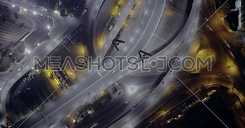 Aerial top shot flying spirally 6 of October Bridge over Abd Elmonan Reyad Bus Station At Tahrir Area in cairo at night