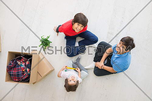 Happy kids sitting on the floor