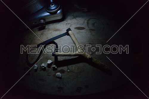 slingshoot weapon toy in dark on wooden  table