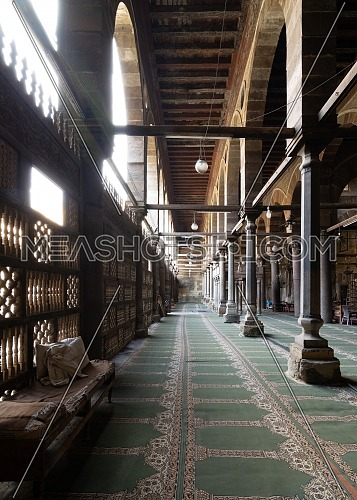 Corridor at public historic mosque of Amir Al-Maridani with wooden arabisk wall - Mashrabiya, Cairo, Egypt