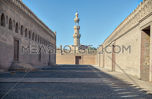 One of the passages surrounding Ibn Tulun mosque with minaret of Amir Sarghatmish mosque at far distance, Sayyida Zaynab district, Medieval Cairo, Egypt