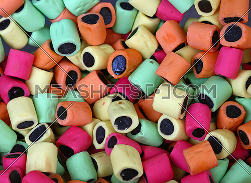 Mix of traditional assorted colorful licorice candies in store, close up, high angle view