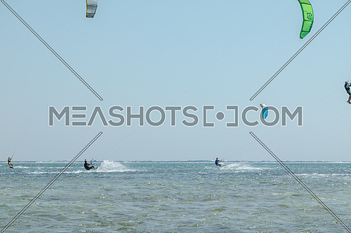 Kite Surfers while surfing in Red Sea at day.