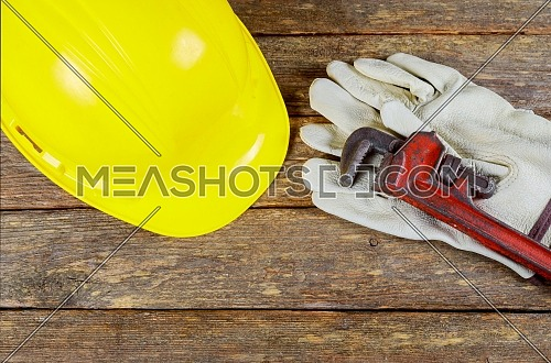 Yellow safety helmet and gloves wrench construction safety equipment