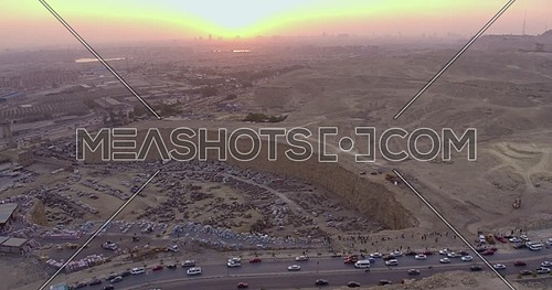 Reveal Shot for Cairo city starting from Wrecking yard at in cairo at sunset