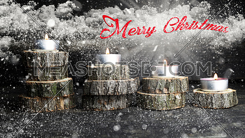 Merry Christmas. Christmas candles burning, decoration on wooden logs resting on rustic wooden background with Snow, Flakes, Stardust, Stars, Clouds and Sun Rays