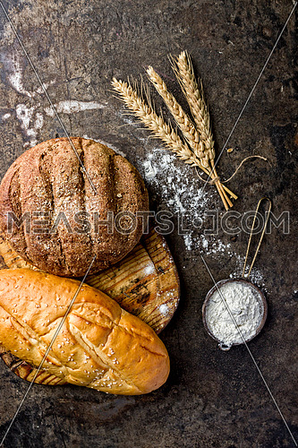 bread wheat and flour put on a black table top