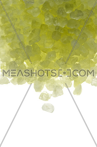 yellow bath salt crystals over white background