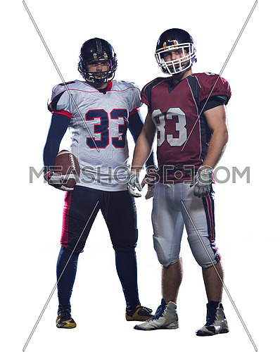 Two American football players standing  on the field isolated on white background