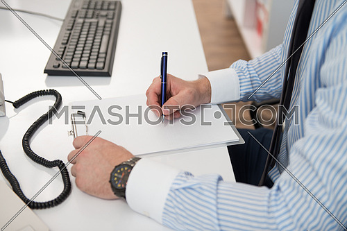 Young Businessman Writing A Letter Close Up - Notes Or Correspondence Or Signing A Document Or Agreement