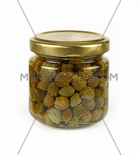 Close up of one small glass jar of pickled capers over white background, low angle view