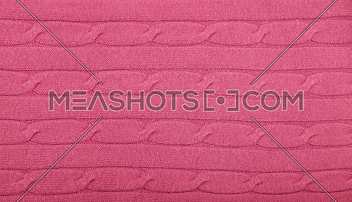 Close up background of pink knitted wool jersey fabric texture