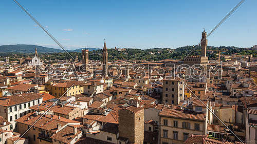 In the picture an aerial view of the old town of Florence