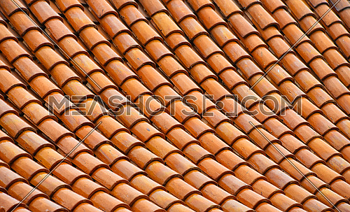 Asian brown and orange glazed ceramic roof scale tiles texture
