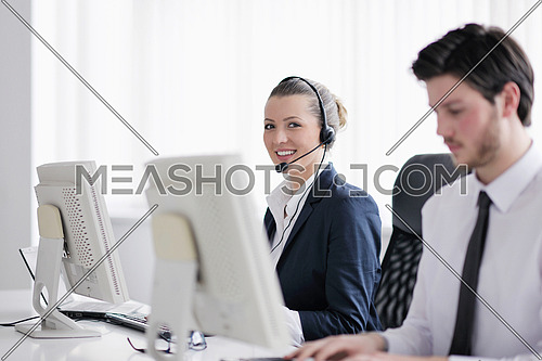 business people group with  headphones giving support in  help desk office to customers, manager giving training and education instructions