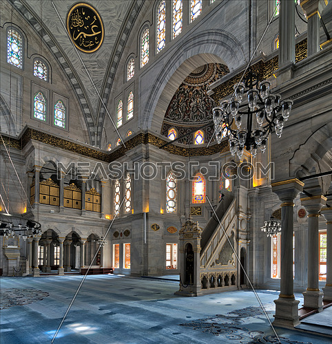 Interior shot of Nuruosmaniye Mosque, an Ottoman Baroque style mosque with minbar (platform), huge arches & colored stained glass windows located in Shemberlitash, Fatih district, Istanbul, Turkey