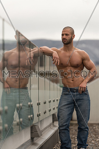 Portrait Of A Physically Fit Young Man Posing Outdoors