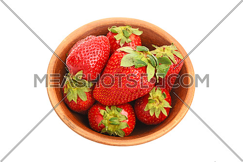 Mellow fresh red summer strawberries in rustic ceramic bowl isolated on white background, top view