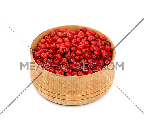 Close up one wooden bowl full of red pink pepper peppercorns isolated on white background, high angle view