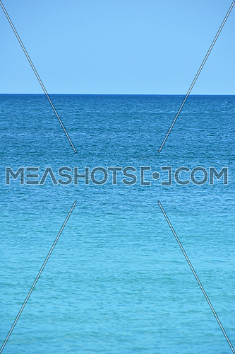 Tranquil seascape of blue sea water and clear sky with horizon, summer day, high angle view