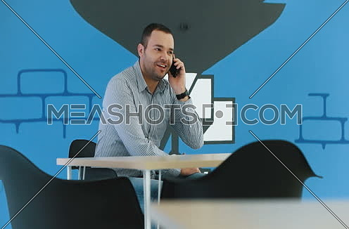 Man using phone in statup office enviroment