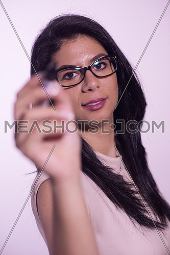 Middle eastern  business woman writing with marker on virtual screen isolated on white background