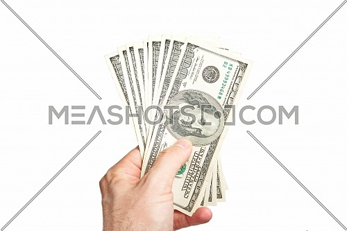 Male hand holding ten bill of hundred dollar isolated on white background