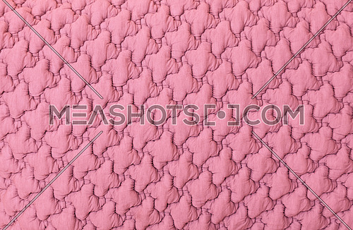 Close up background texture of pink soft tufted textile upholstery pattern