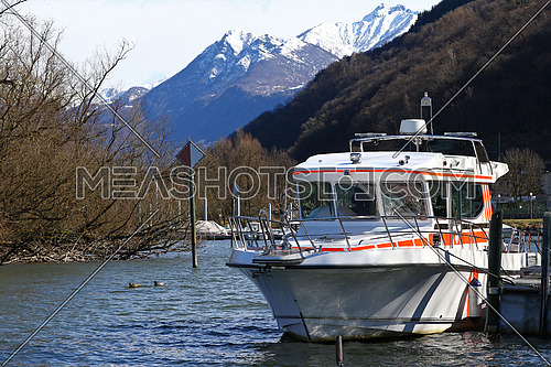 Rescue boat docked in a canal by a lake in the mountains