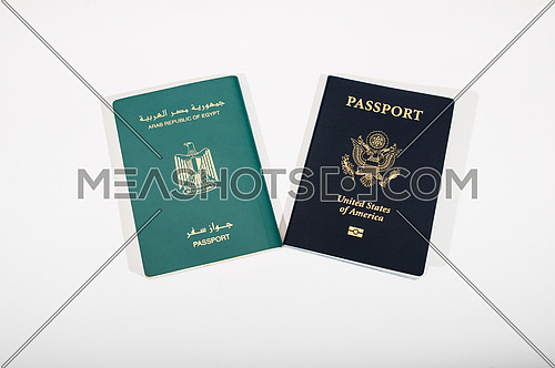 Egyptian and american passports isolated on white