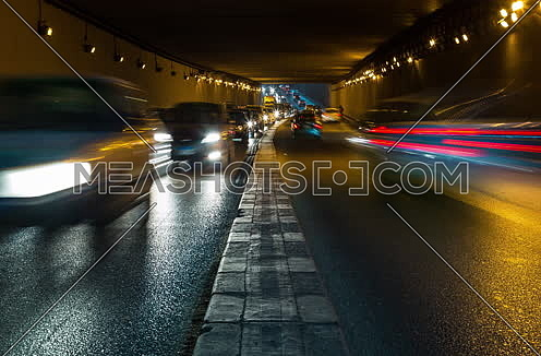 Fixed Shot for traffic from inside  Al Thawra Tunnel at Night