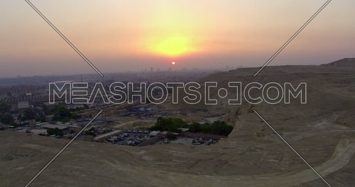 Reveal Shot for Cairo city showing Wrecking yard at in cairo at sunset