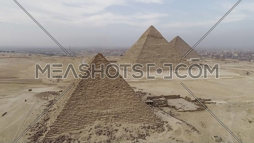 Fly-Up Shot for The Great Pyramids of Giza Area in Cairo by day.
