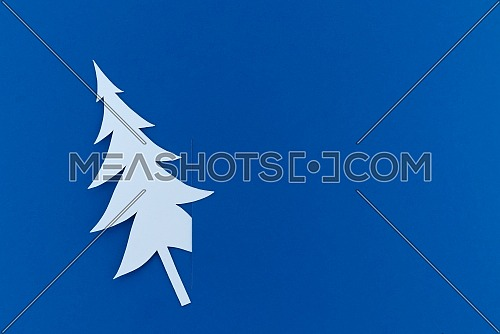Christmas postcard with paper cut christmas tree. Holiday postcard concept with copy space
