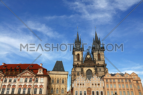 Low angle view of historical center of Old Town Square and Cathedral of Our Lady before Tyn over clear blue sky, Prague, Czech Republic