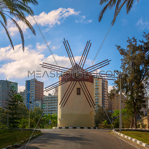 Old traditional windmill at Montaza public park in sunny summer day, Alexandria, Egypt.