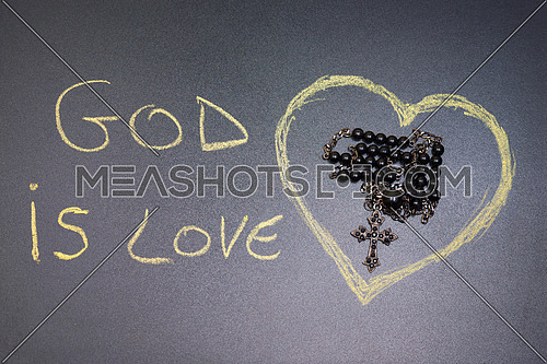 In the picture a rosary iron at the center of a heart drawn on the left side the word \