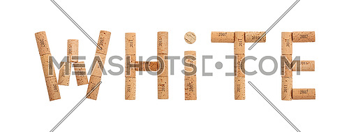 Word WHITE shaped by natural wooden wine bottle corks of different vintage years isolated on white background