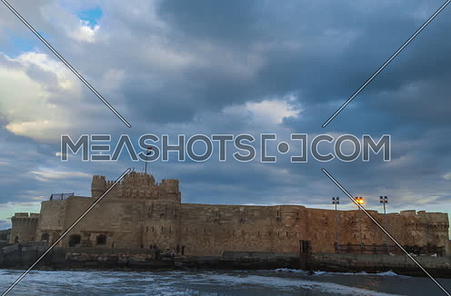 Track Right Long Shot outside Citadel of Qaitbay shows sea waves at Cloudy day