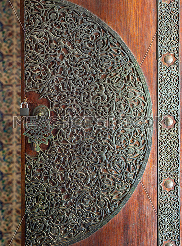 Wooden decorated copper plated door from the royal era, Manial palace of Prince Mohamed Ali, Cairo, Egypt