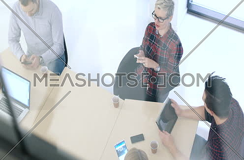 top view of Creative Business Team Meeting In Modern Start Up Office