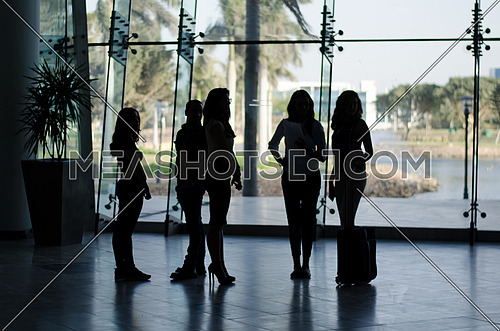 Group of ladies standing in a business office