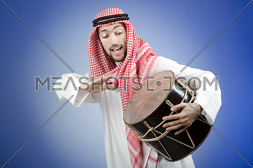 Arab playing drum in studio shooting